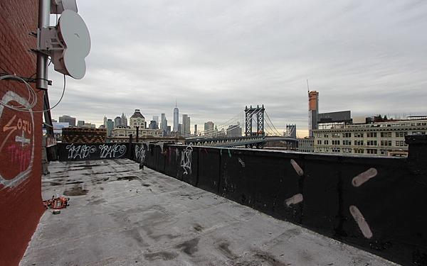 Dumbo Rooftop Overlooking Hudson with Manhattan Bridge Views